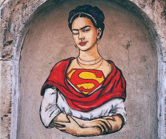 Painting of a woman baring the Superman symbol.