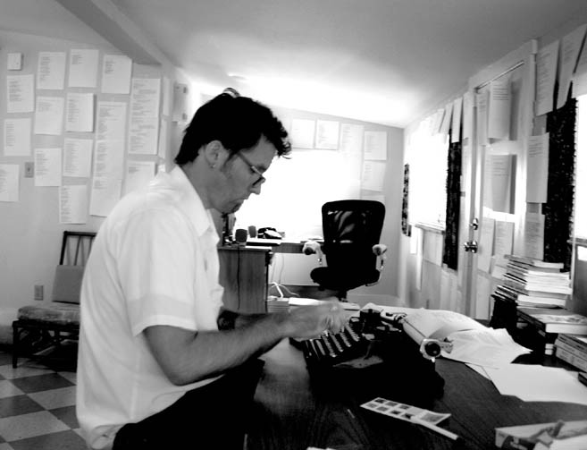 Christopher Watkins, typing while in residence at The Kerouac House