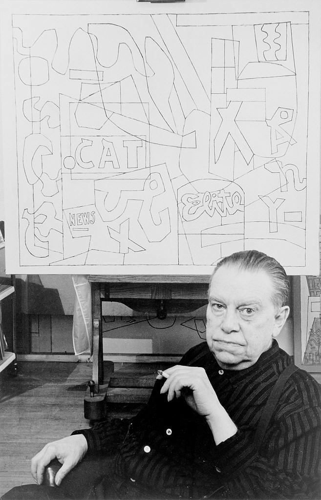 "Stuart Davis takes a moment for a cigarette break in front of a graphic sketch for ""Pochade."""