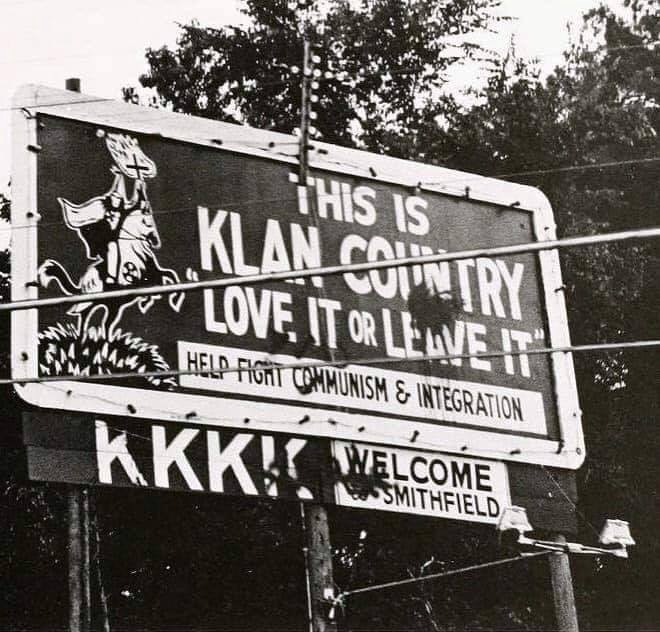 "KKK Billboard from the 1970s saying, ""This is Klan country. Love it or leave it."""