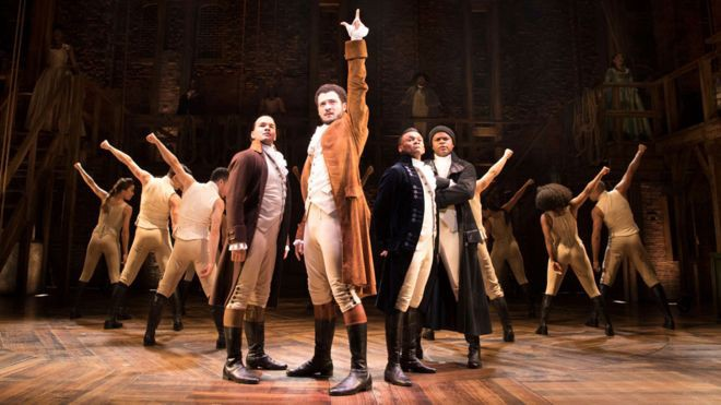 Jamael Westman, centre, plays Alexander Hamilton at the refurbished Victoria Palace in London (photo: Matthew Murray)