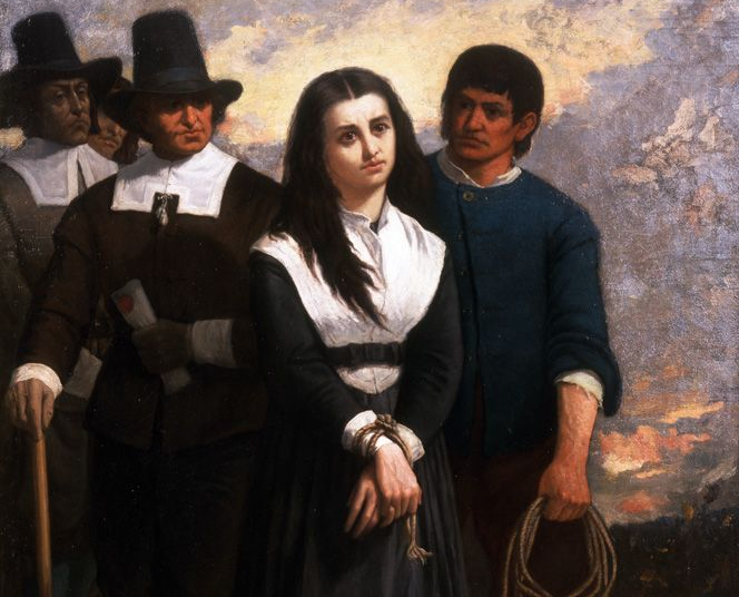 Salem witch trials: Stern Puritan men lead a young accused witch to be hanged. Her hands are bound and she looks sad.