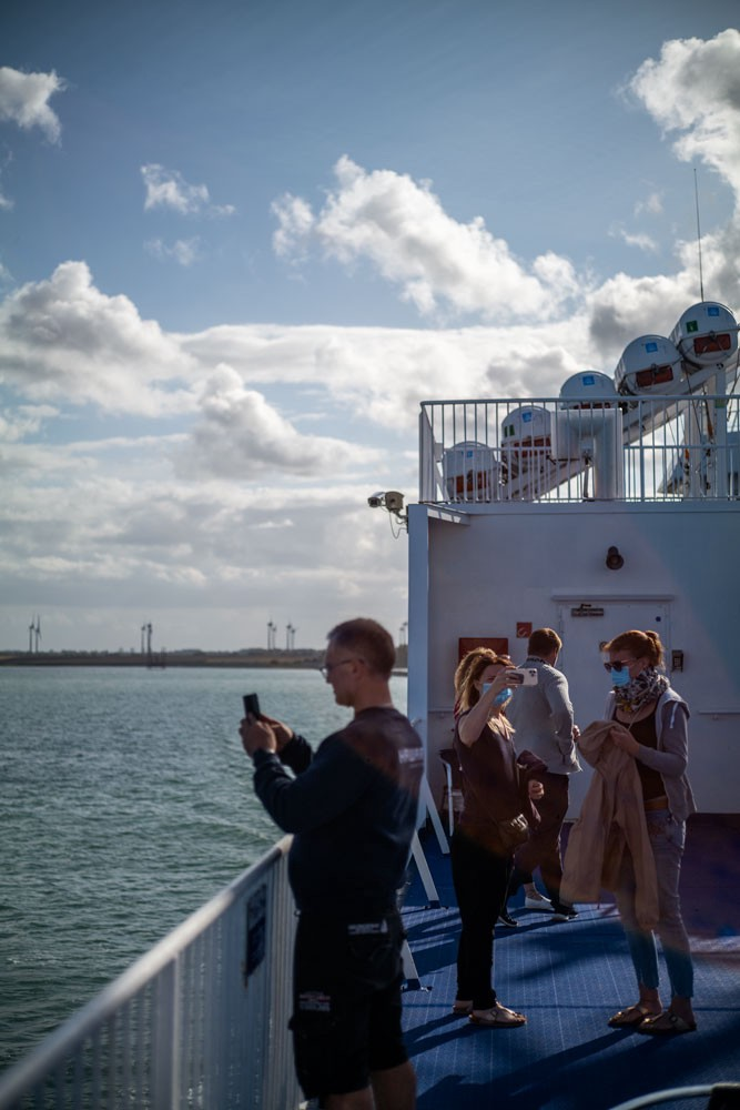 People photographing things on a ferry in Denmark.