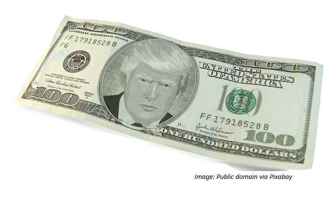 An drawing of Donald Trump's face on a $100 bill.