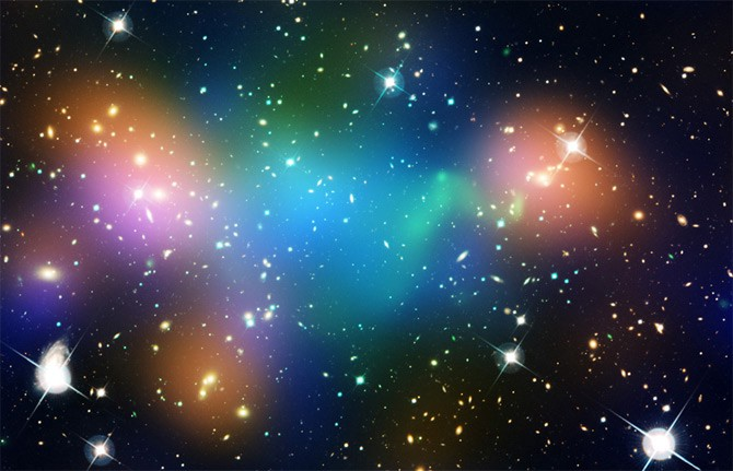 Two galaxy clusters racing away from each other, leaving behind gas collecting where dark matter was left behind.