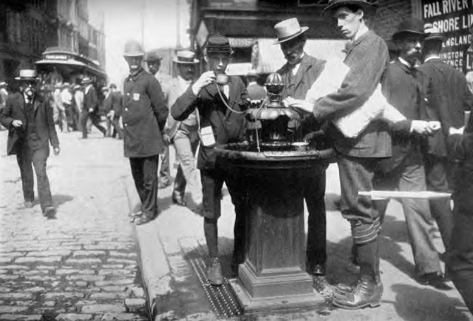 """Communal drinking cups (the """"tin dippers"""") were a common practice in late 19th century public fountains."""