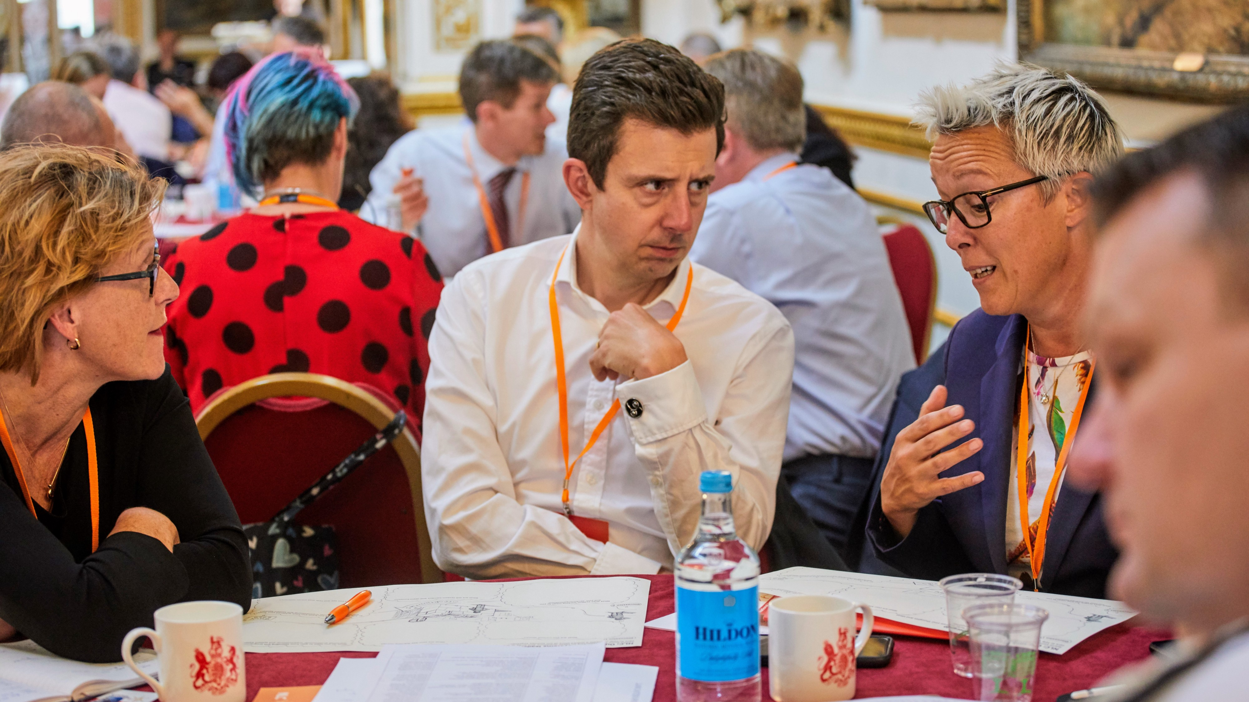 A table of people in discussion at the NLC launch event