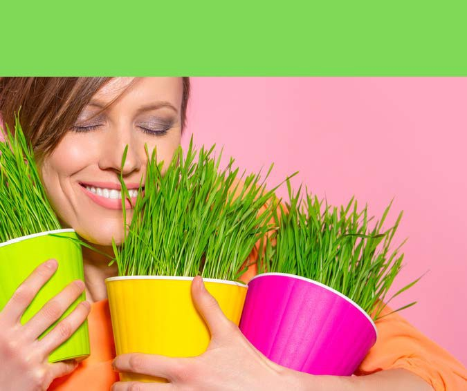 HodgeonRepeat blog—Weight Maintenance Matters—Smiling woman holding pots of grass