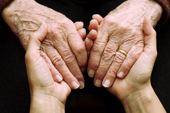 Young and Old— hands in hand.