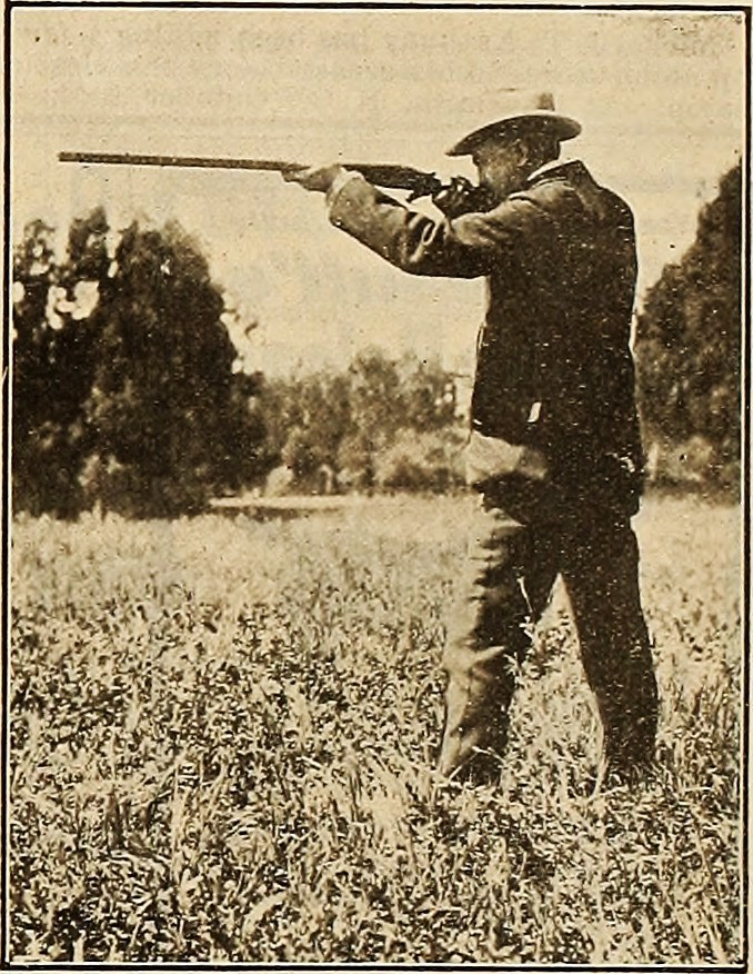 Sepia photo of hunter shooting with shotgun
