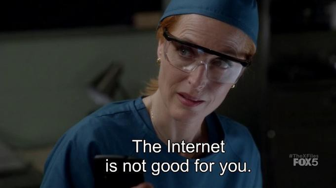 "Agent Scully is wear lab glasses and blue scrubs as she looks condescendingly at Mulder off-screen. Caption reads: ""The Internet is not good for you."""