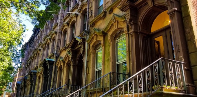 Angled shot of the front stoops of the historic Brownstone buildings in New Haven.