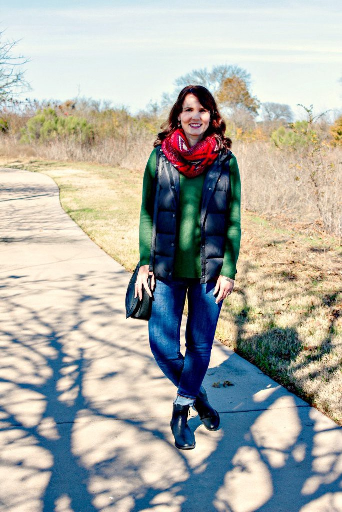 A Casual Holiday Outfit Green Sweater Black Puffer Vest