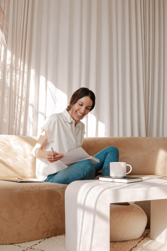My Spring Morning Routine And How To Make Yours In No Time. the lazy gal medium.com women sitting down on couch reading sejal ghanate