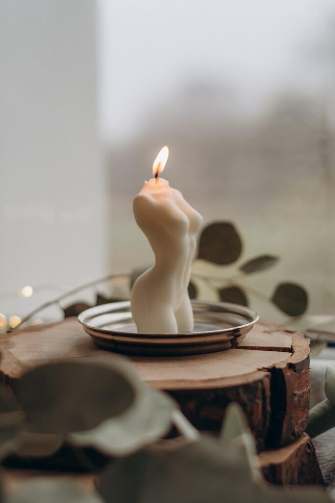 female body figure candle representing a woman on her period