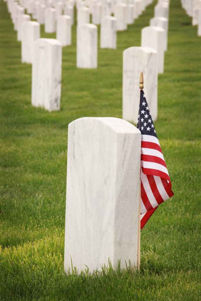 photo of USA flag on gravestone posted on Mickey Markoff article about Memorial Day.