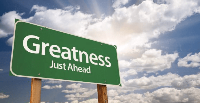 "Road sign saying ""Greatness Just Ahead"""