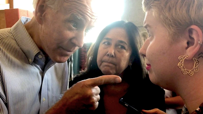 Biden misogynistically waging his finger at a woman's rights activist (2019).