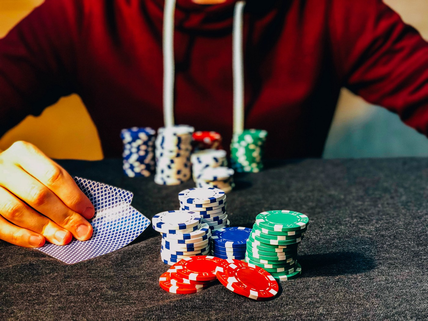 A poker player looking at his cards