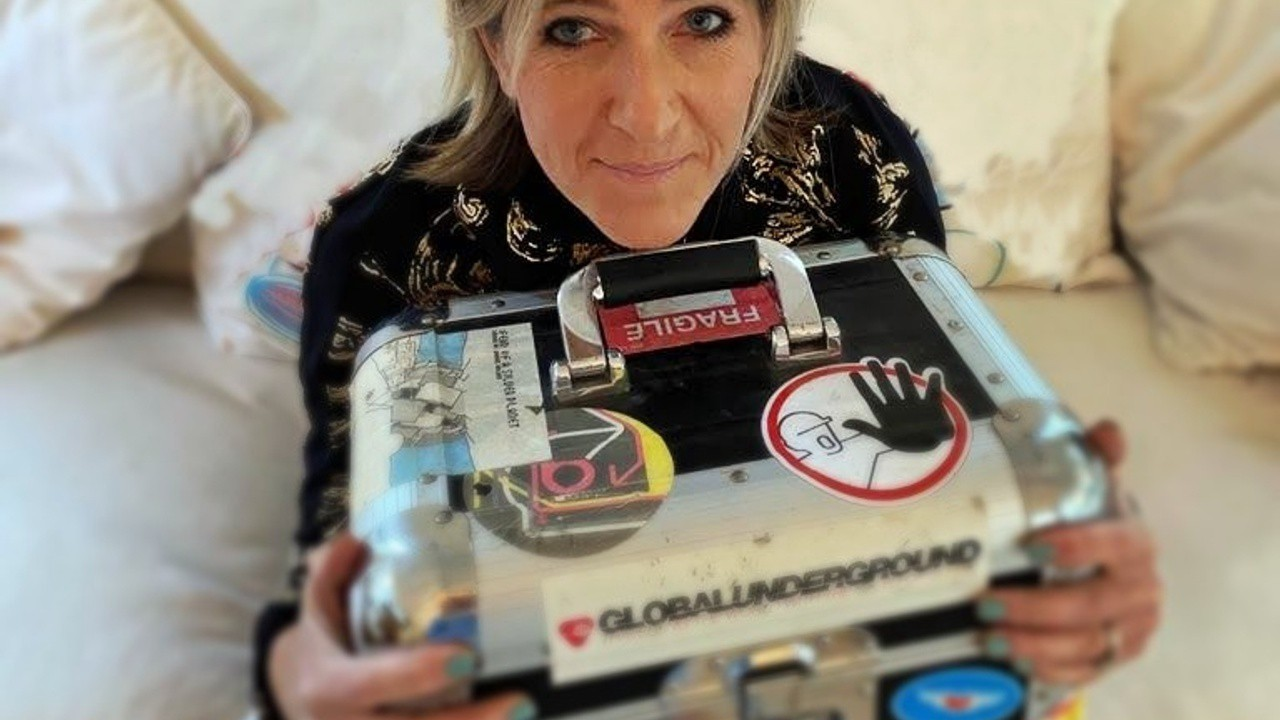 Nina Pearse holds a collector's item record case with vinyl dance records for sale