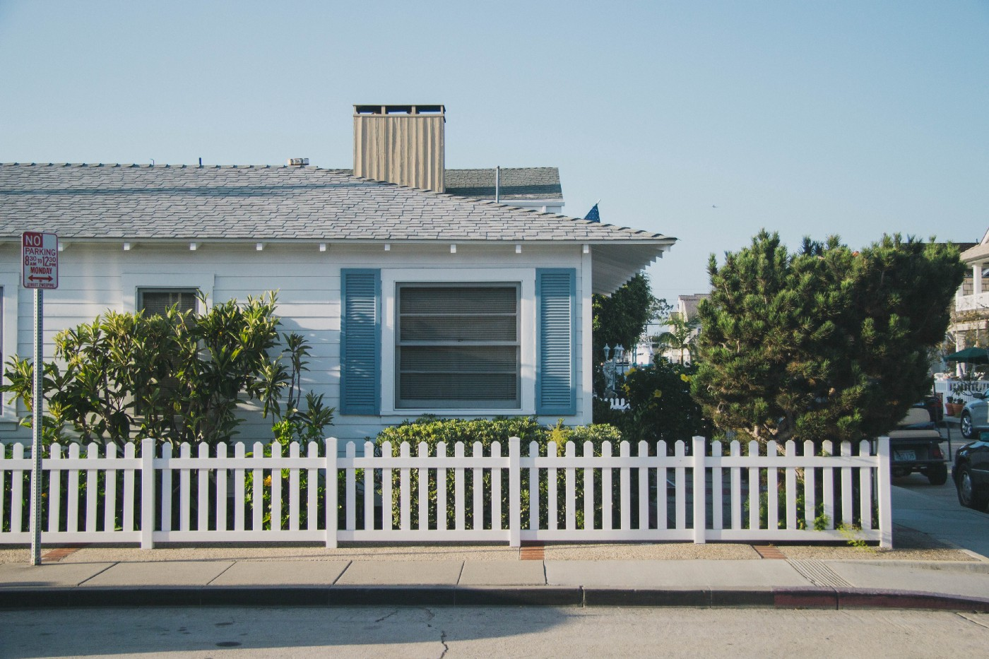 House with white picket fence and blue sky