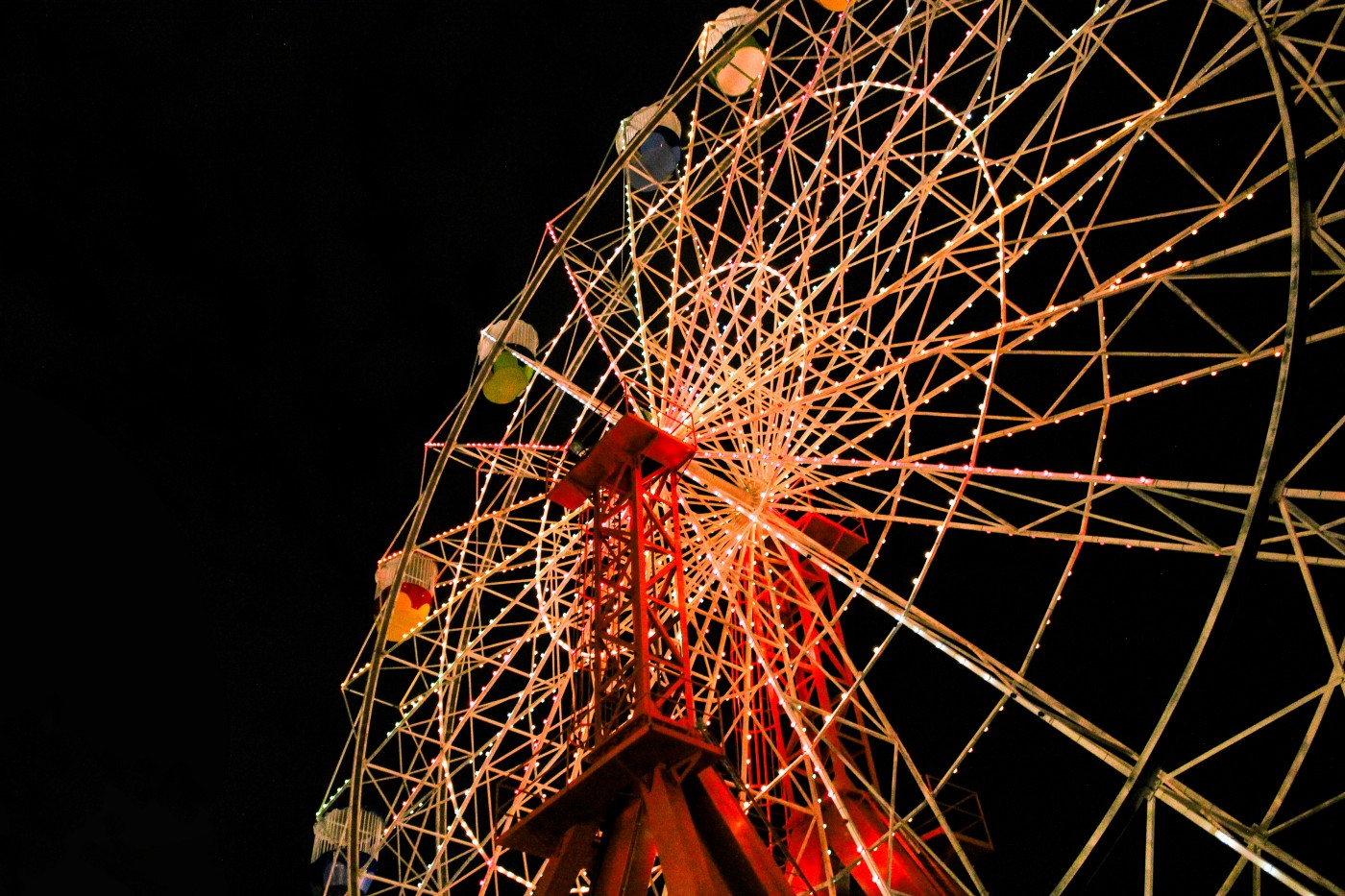 A lit-up Ferris wheel against the night sky.