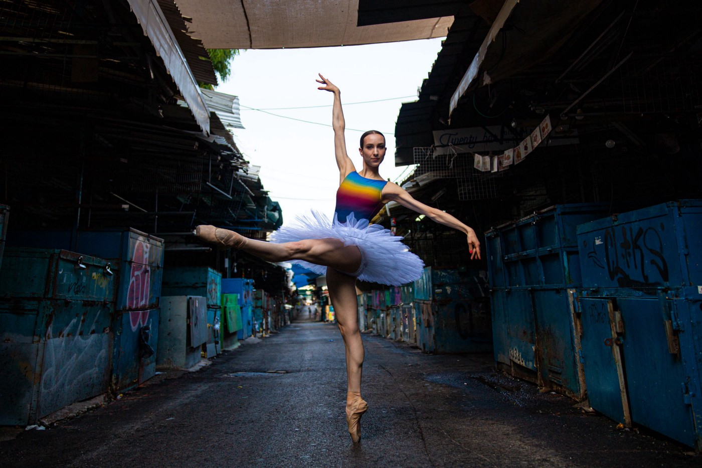 A ballerina dances in a street.