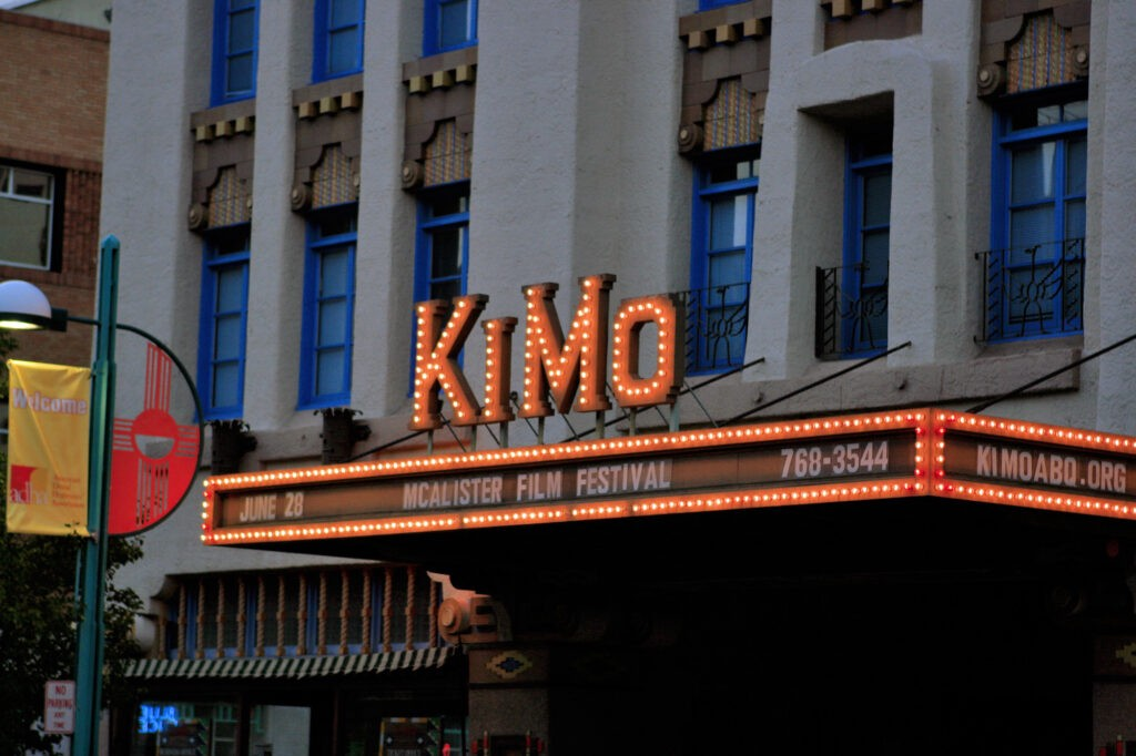 Close-up of red neon sign that reads KiMo