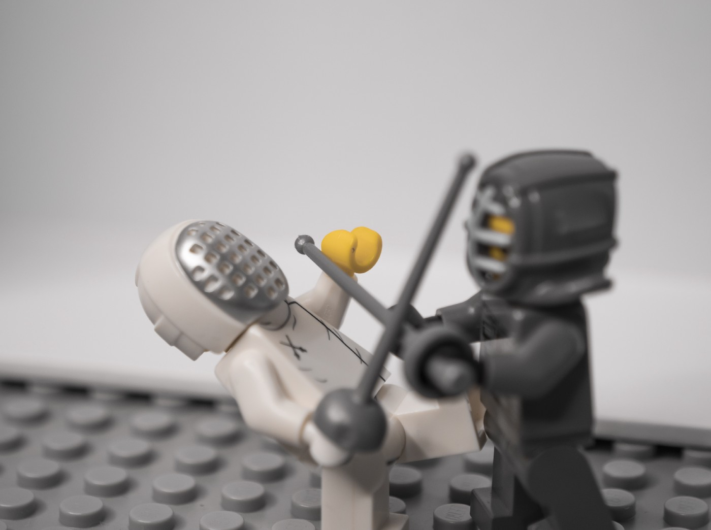 Two Legos fencing
