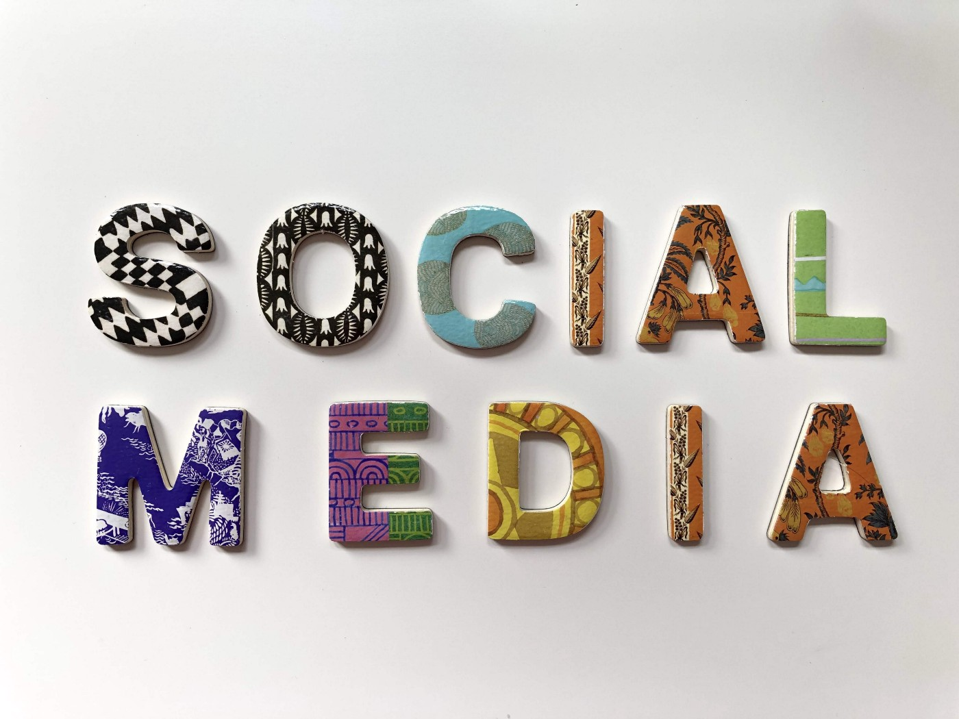 """The words """"Social Media"""" spelled out with resin letters in bold designs."""