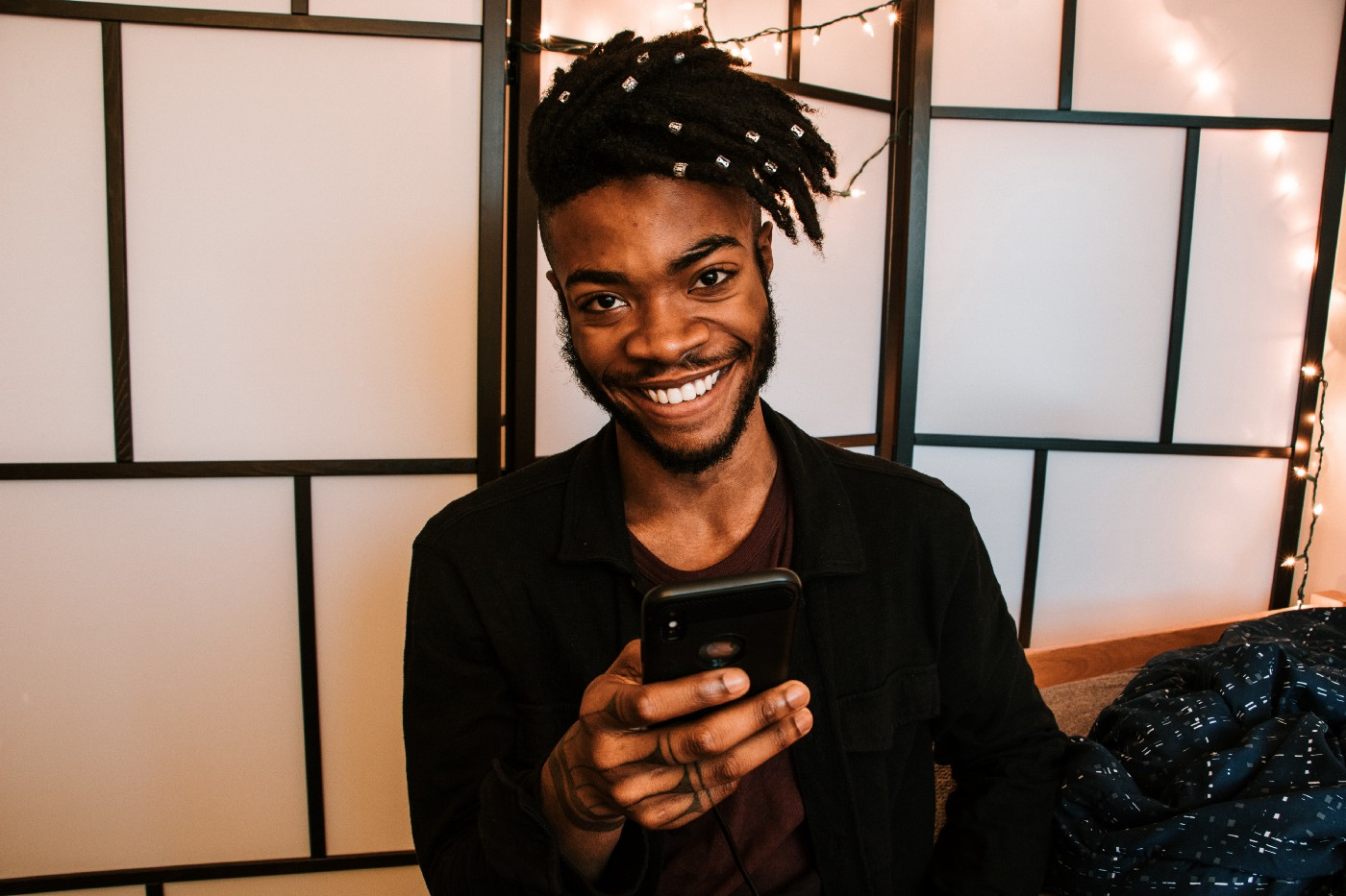 Smiling person with smart phone.