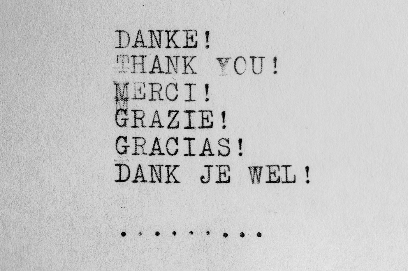 thank you in multiple languages written with a mechanical typewriter