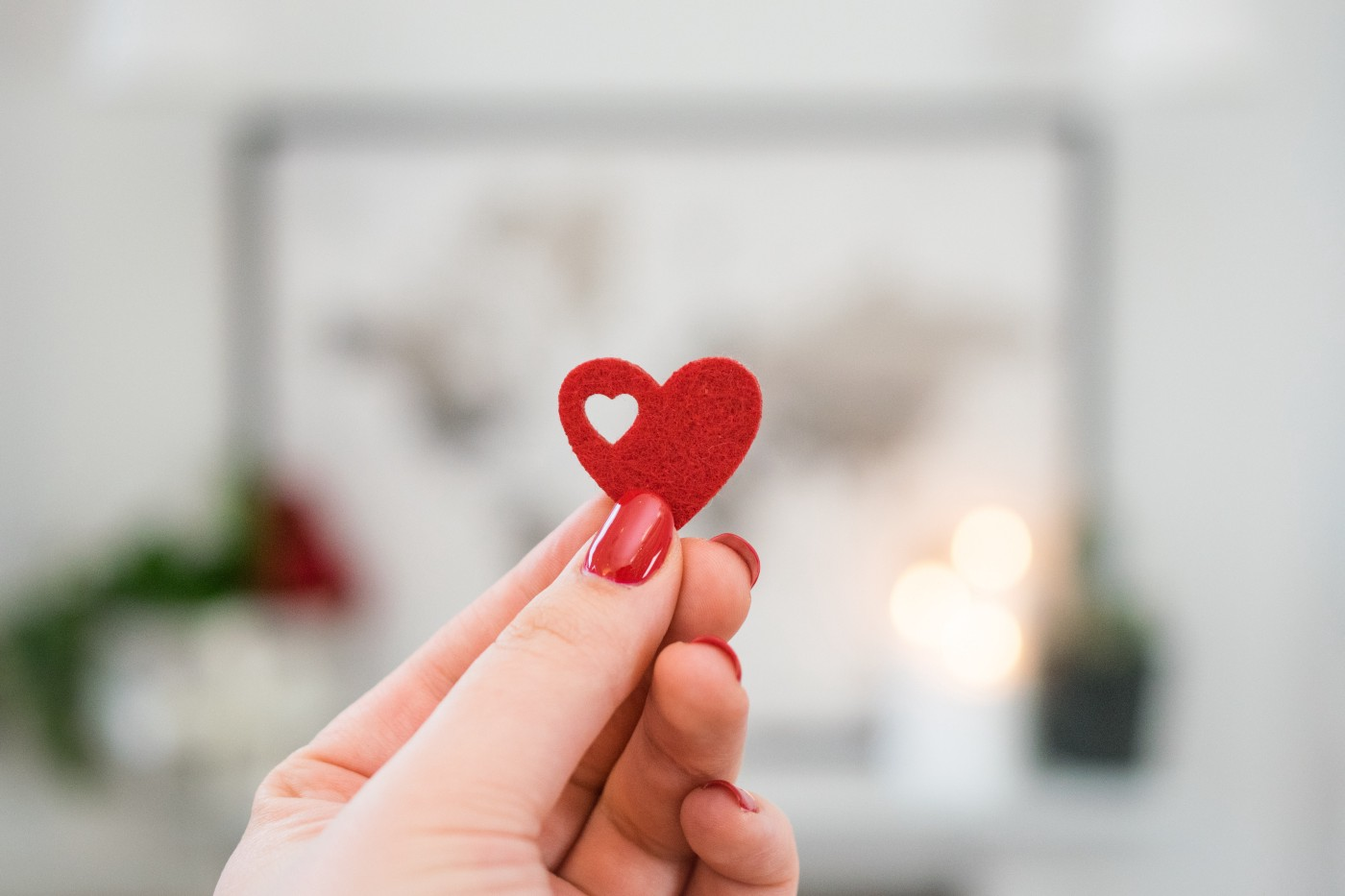 a person holding a tiny valentine heart