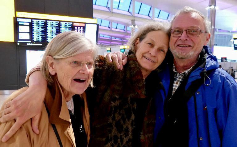 Lena, diagnosed with Alzheimers, in an embrace with her brother and sister-in-law in the airport arrivals terminal.
