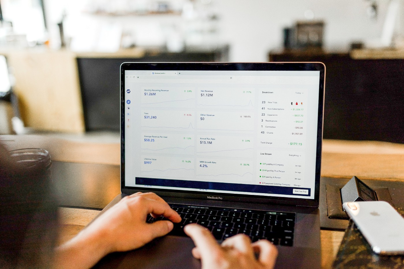 A person reviews their personal finance dashboard on their laptop