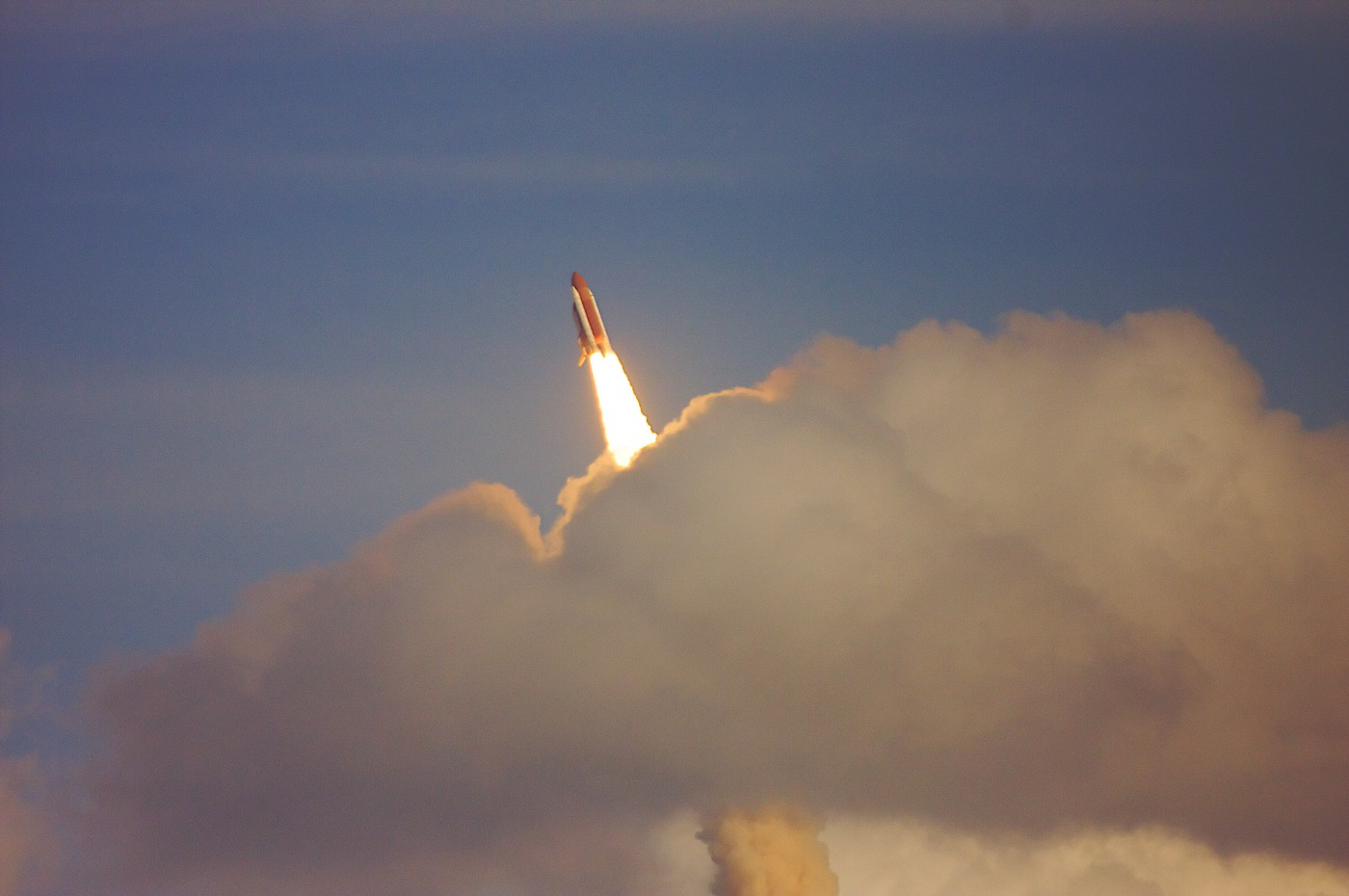 rocket shooting through clouds