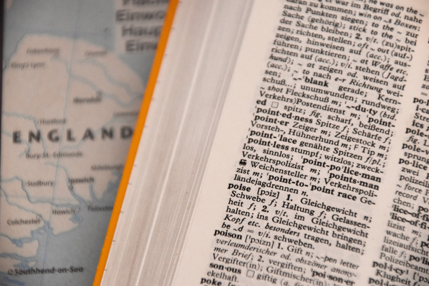 An open dictionary on top of a map of England