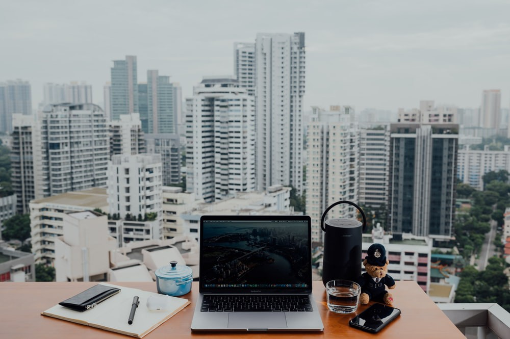 A standing desk looking out on a city view