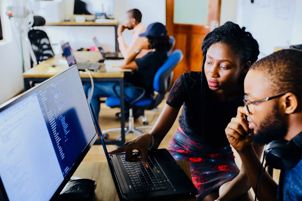 image of two users working together on a computer