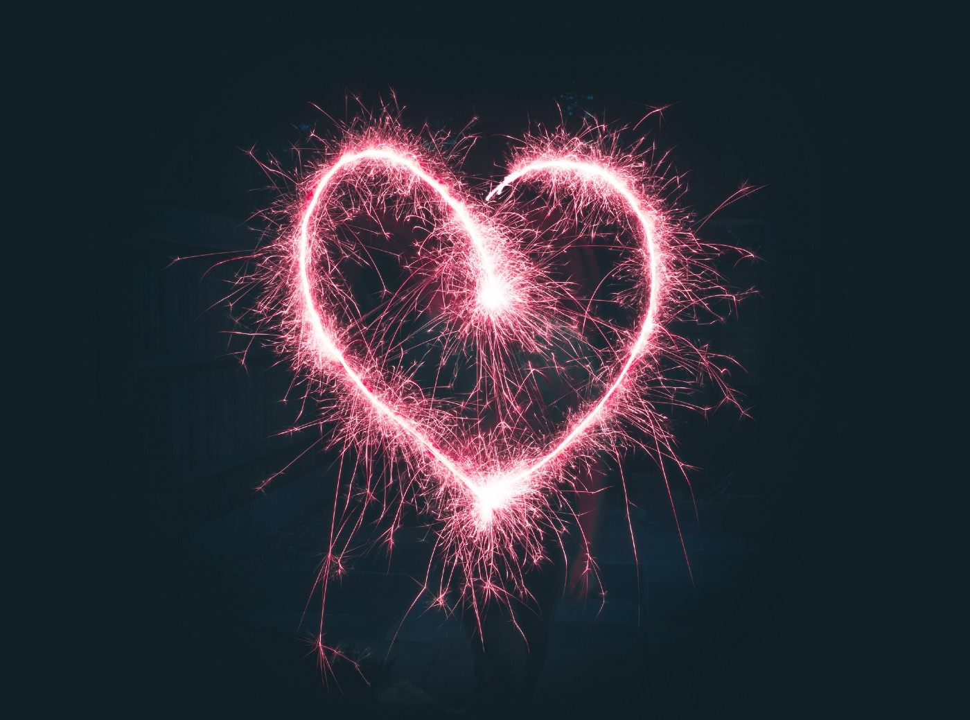 A heart made by fireworks in a black sky