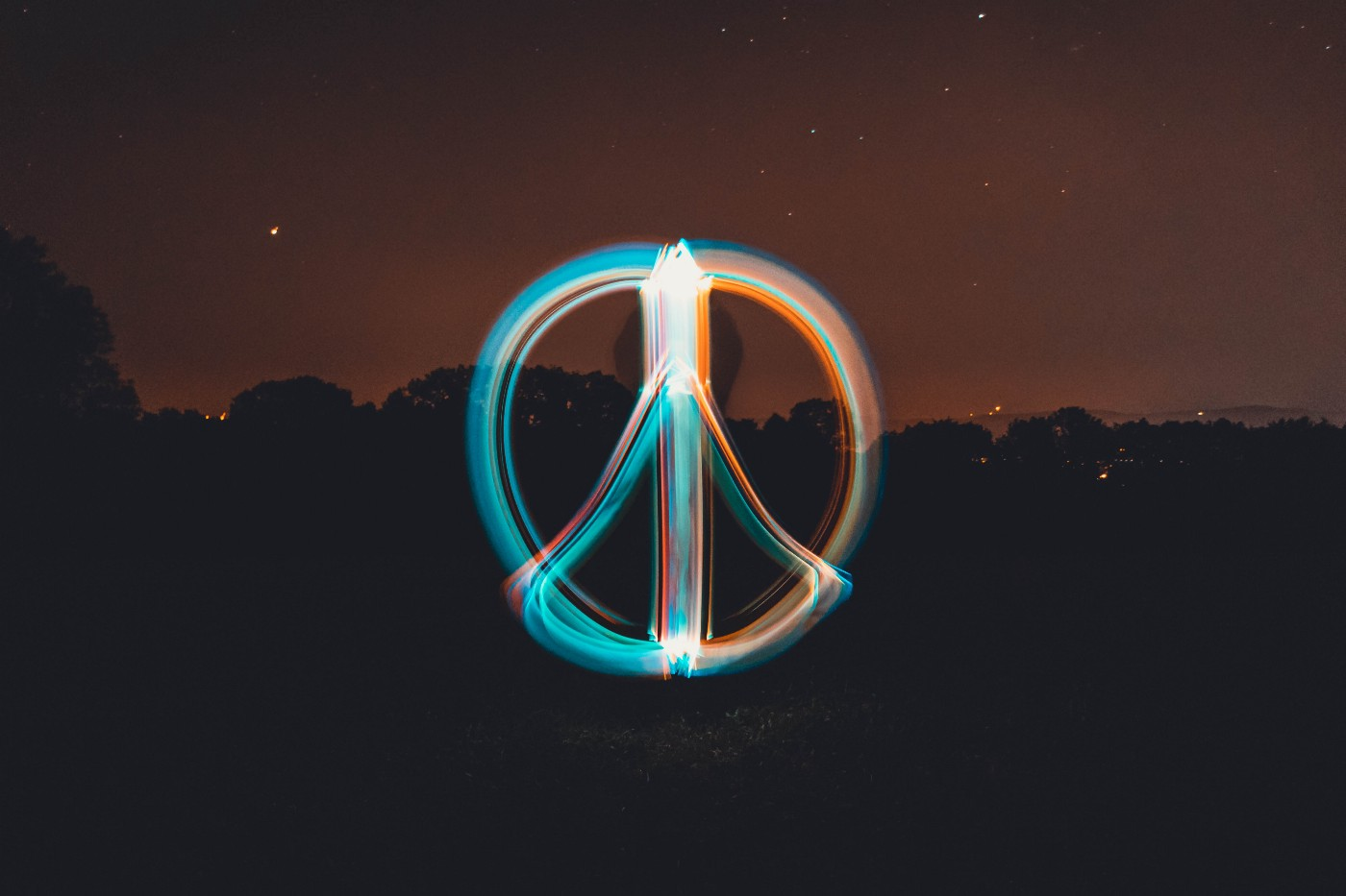 A peace sign glowing in the dark.