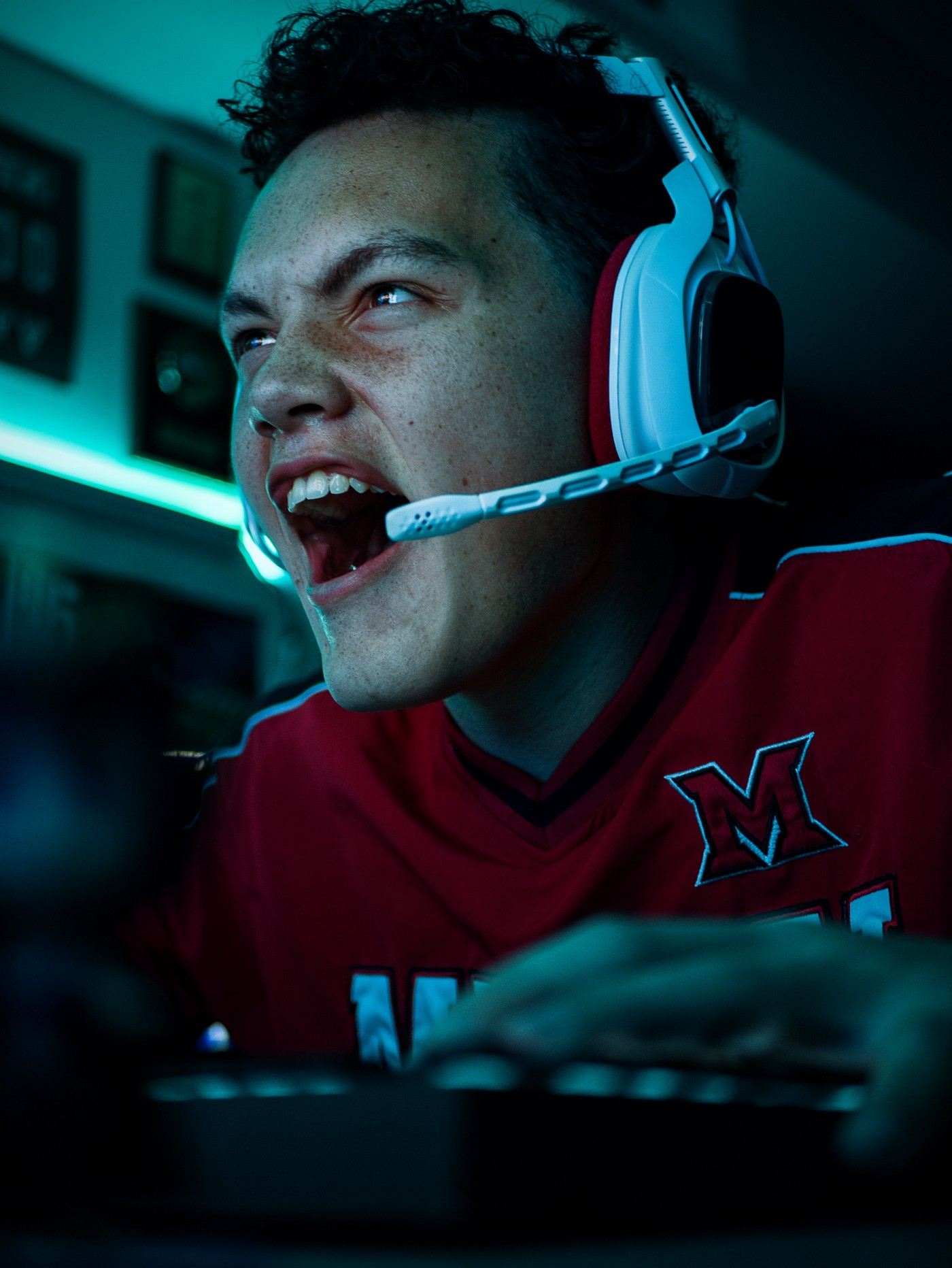 Young man screaming with Headsets on
