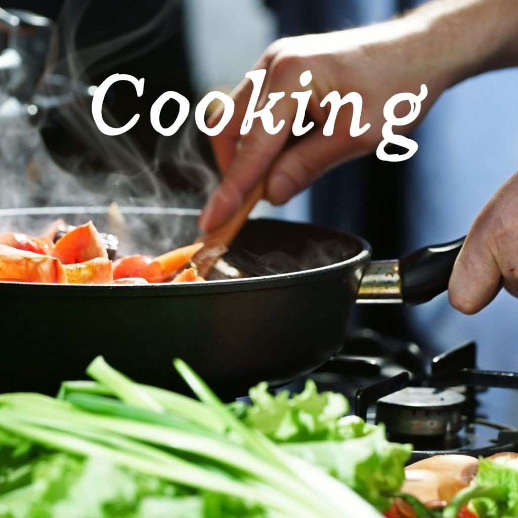 Someone cooking at a stove. Close up of hands and pan.