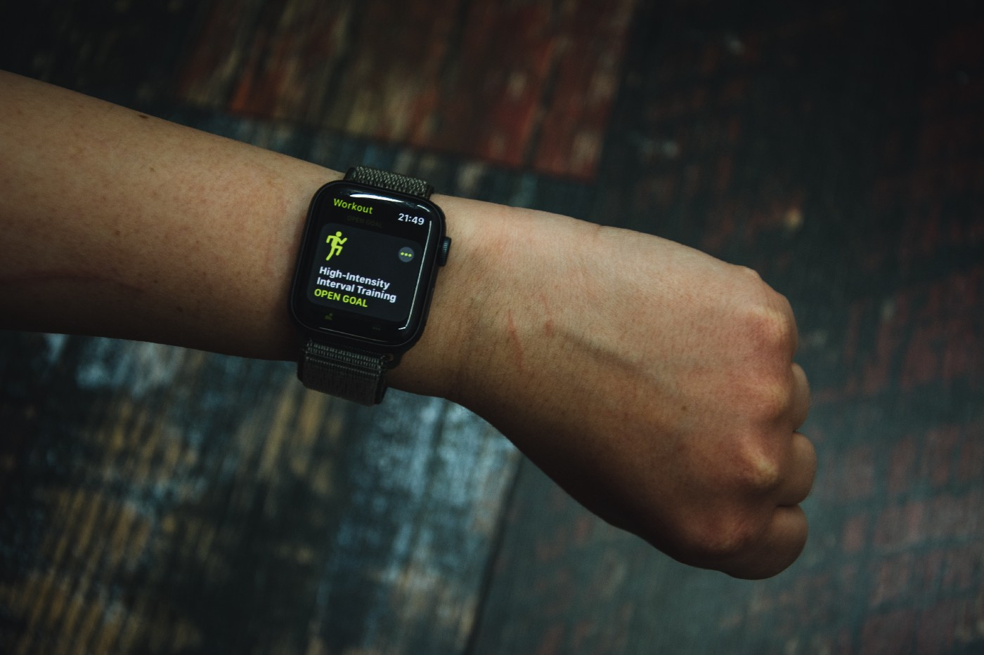 looking at a person's wrist with their smart watch showing it's about to track high intensity interval training