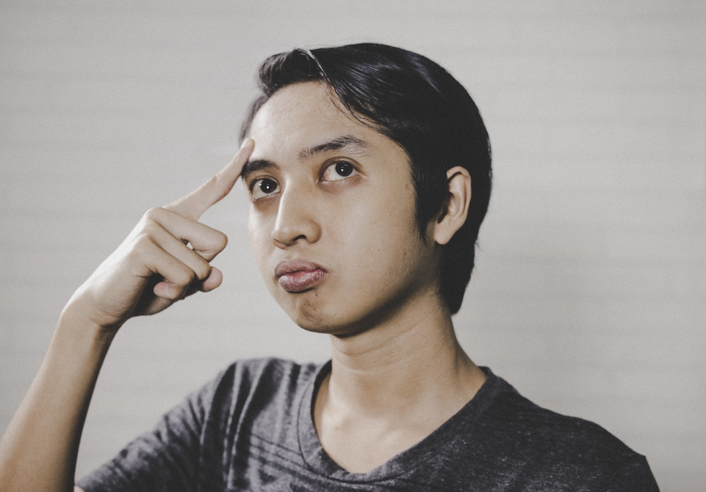 person in a pose that suggests they're considering alternatives