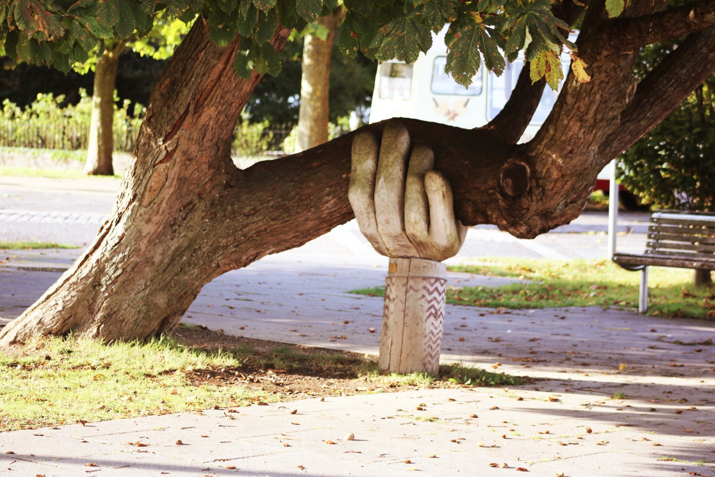 Tree supported by a large sculpted hand