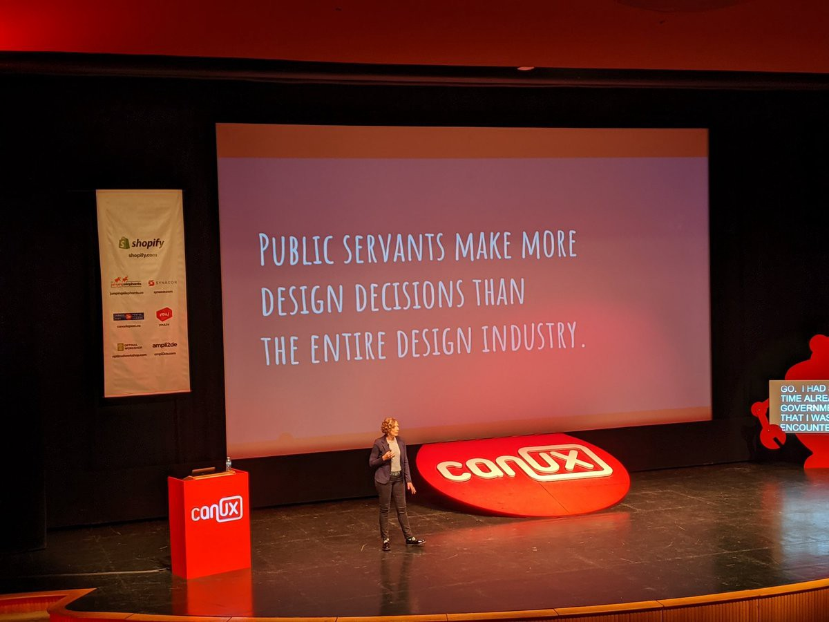Cyd Harrell with slide behind her that says 'public servants make more design decisions than the entire design industry'