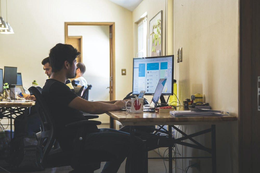 Person at desk sitting in front of computer