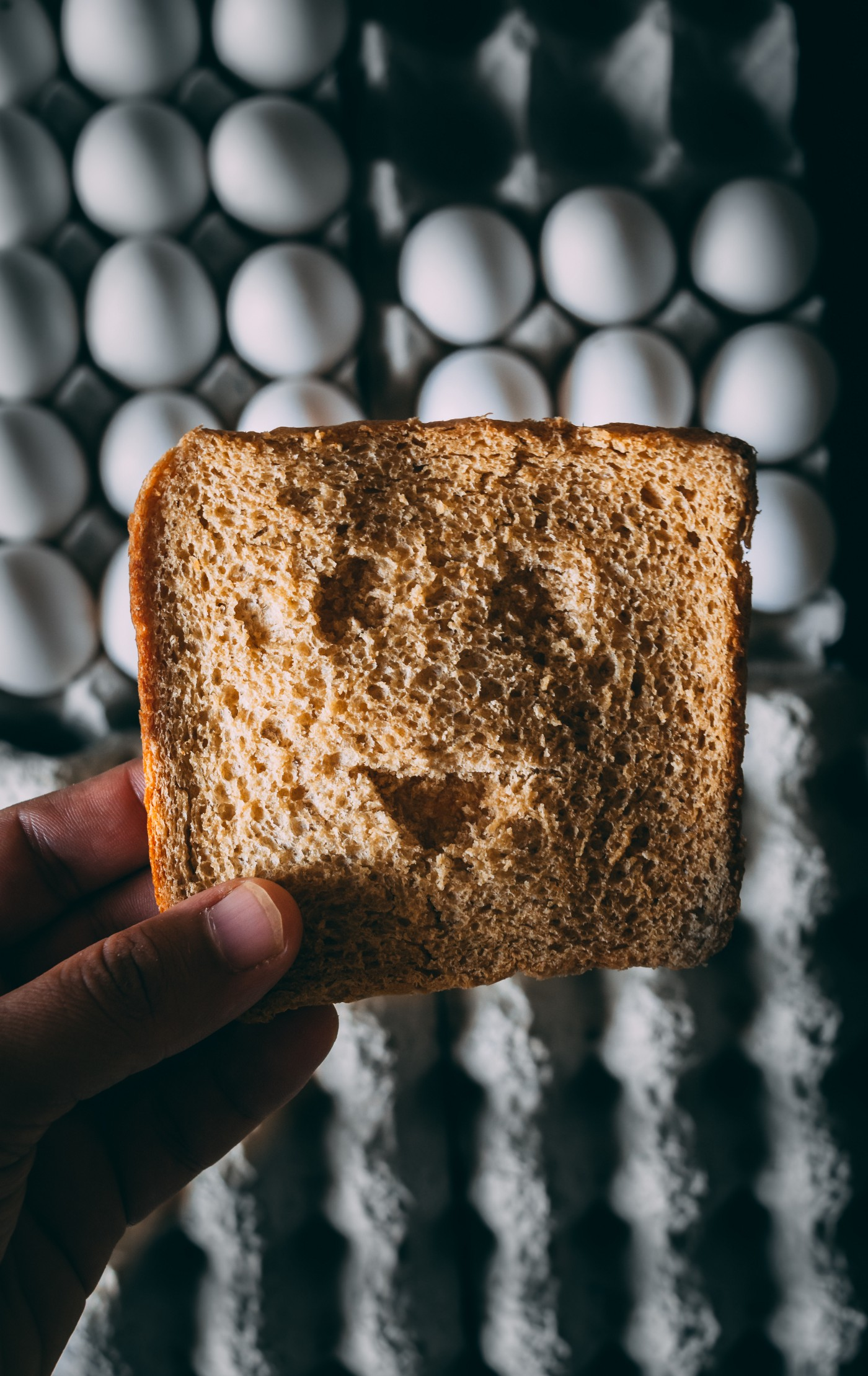 piece of toast with funny face carved into it
