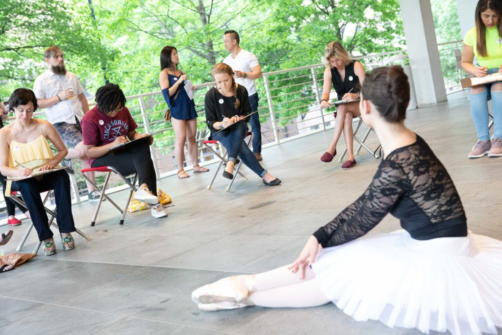A ballerina serves as a figure model for a live drawing class on the High's outdoor terrace.